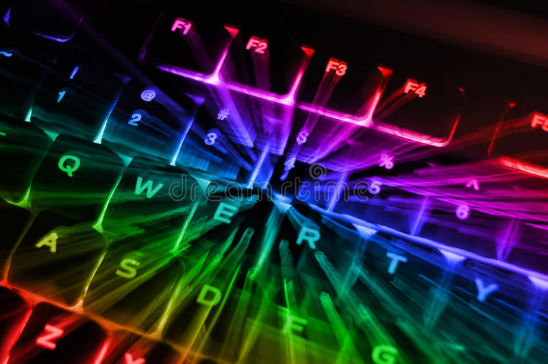 bakbelyst tangentbordregnbåge royaltyfria foton