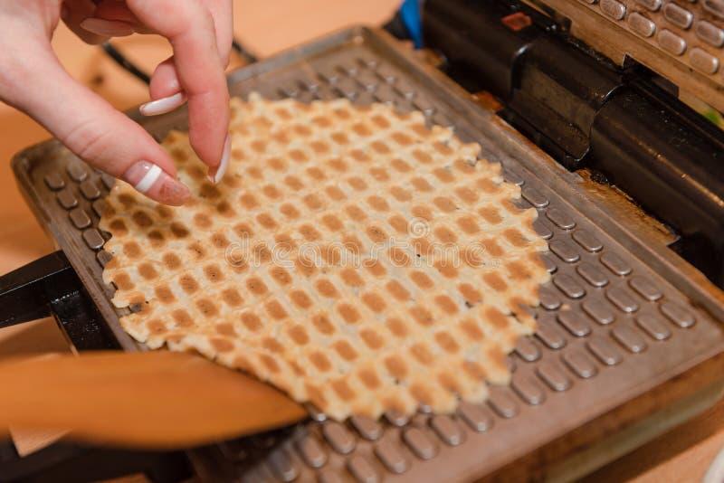 Bake waffles. Home cooking. Cooking waffles at home. Natural food. Cooking royalty free stock photo