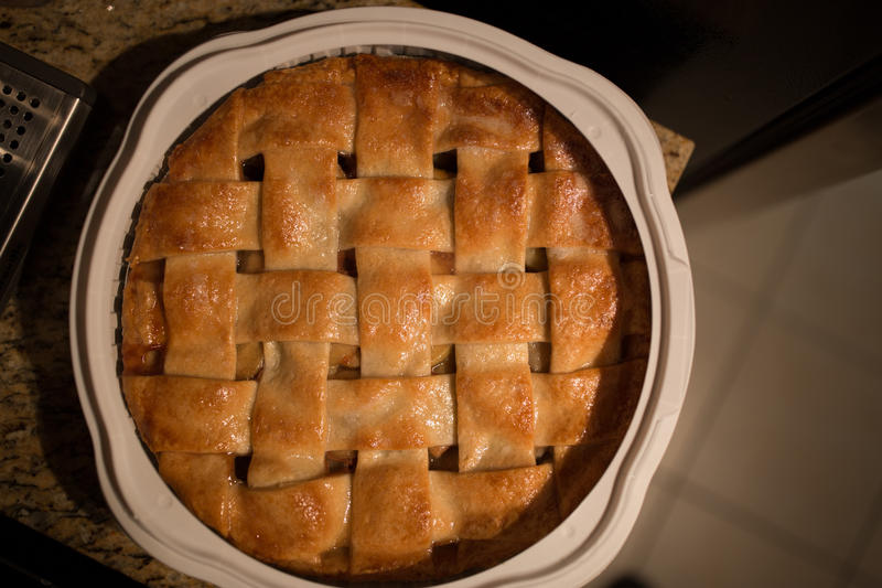Baked Apple Pie. An apple pie sits on the counter stock photography