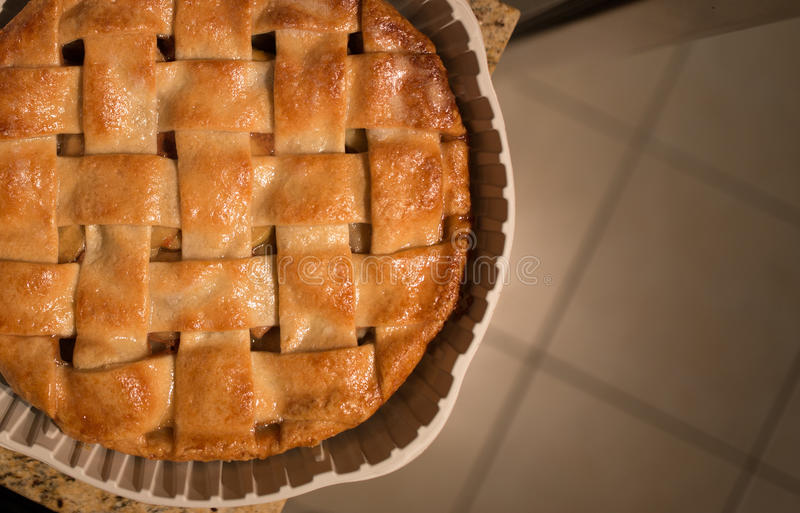 Baked Apple Pie. An apple pie sits on the counter royalty free stock image