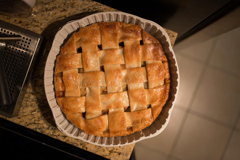 Baked Apple Pie. An apple pie sits on the counter royalty free stock images