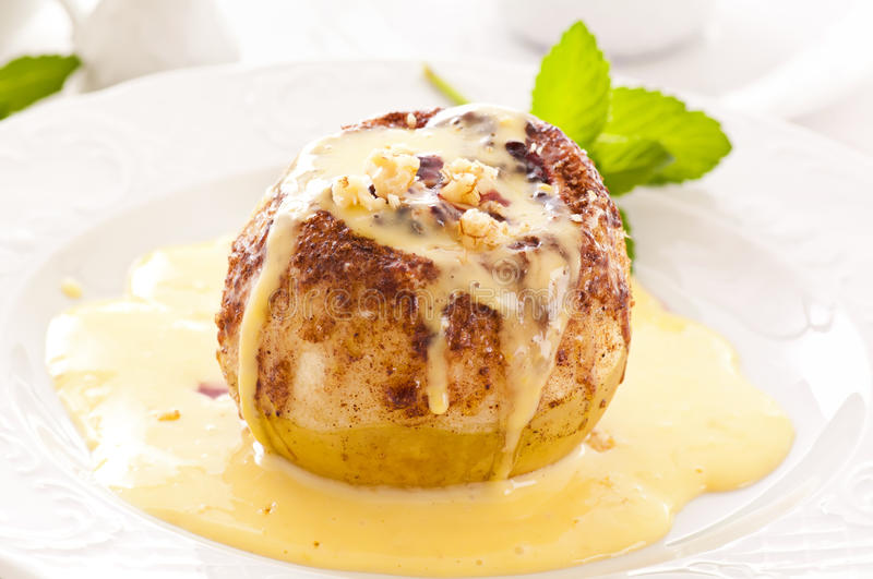 Baked apple with sauce royalty free stock photo