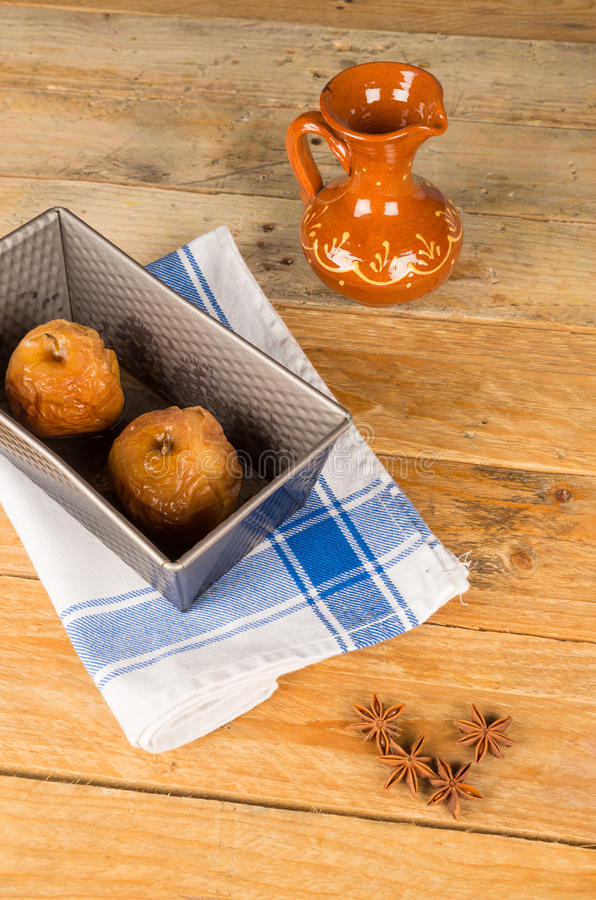 Baked apples inside tin stock images