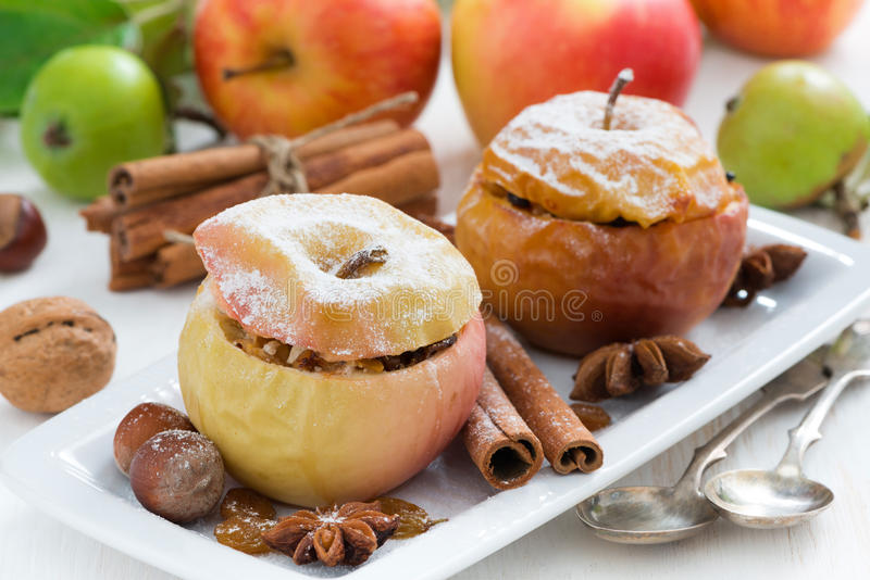 Baked apples stuffed with dried fruit, nuts and cottage cheese stock photo