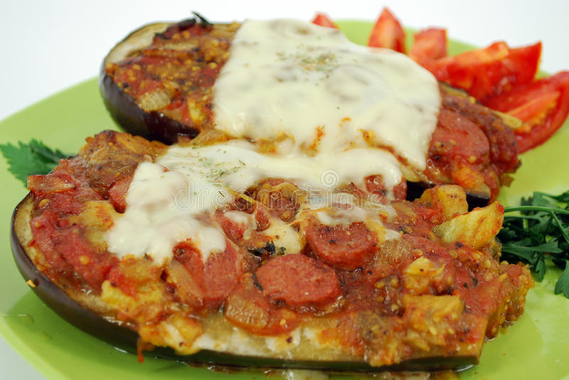 Baked aubergine. With sausage and cheese royalty free stock image