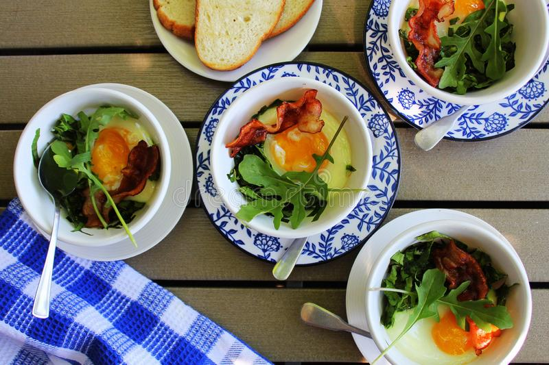 Baked Bacon and Egg Cups with Spinach, Cheese and arugula . stock photos