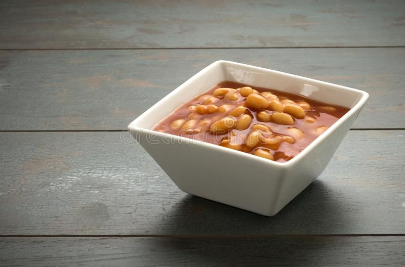 Baked Beans. A bowl of delicious baked beans stock image