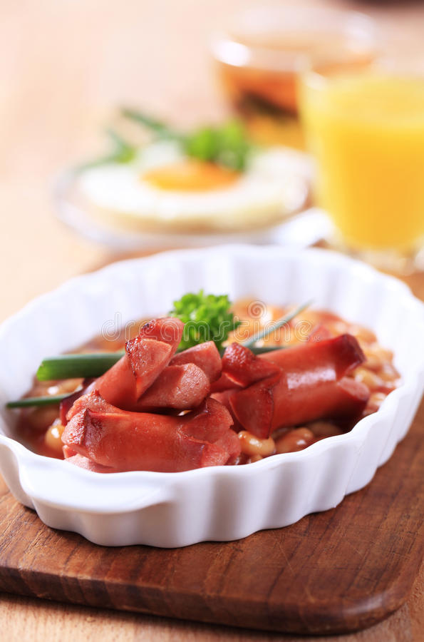 Baked beans with grilled sausages royalty free stock image