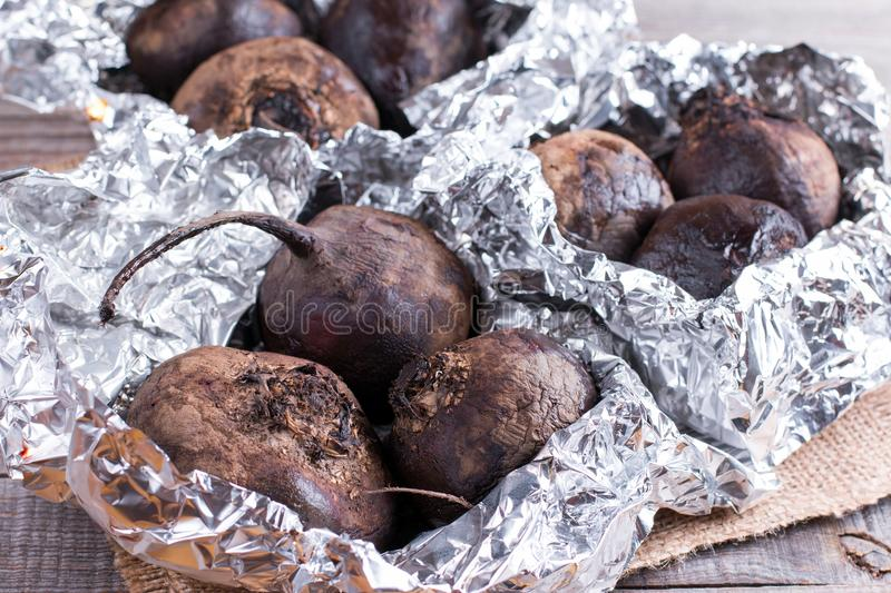 Baked beet in aluminum foil stock photography