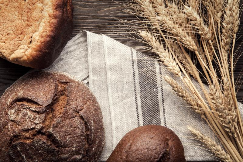 Download Baked Bread On Wooden Table Background Stock Image - Image of baguette, brown: 117122583