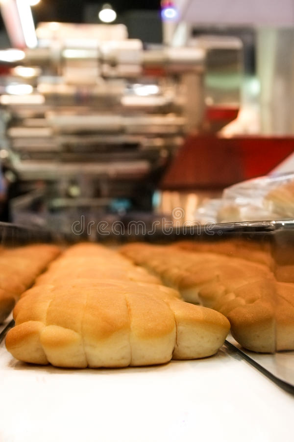 Baked Breads on the production line royalty free stock images