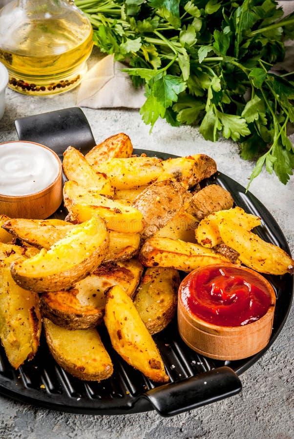 Baked briet Kartoffeln lizenzfreies stockbild