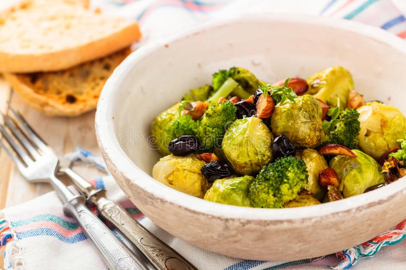 Baked Brussel sprouts. With almonds and grapes royalty free stock photos