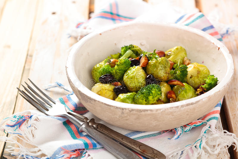 Baked Brussel sprouts. Baked Brussel sprouts with almonds and grapes stock photography