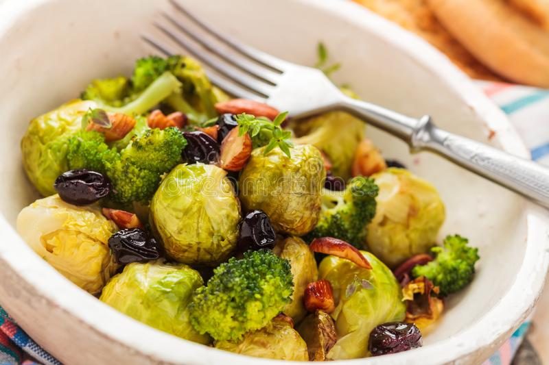 Baked Brussel sprouts. With almonds and grapes stock images