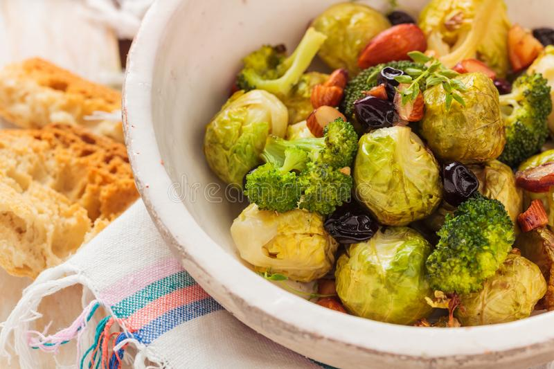 Baked Brussel sprouts. With almonds and grapes stock photos