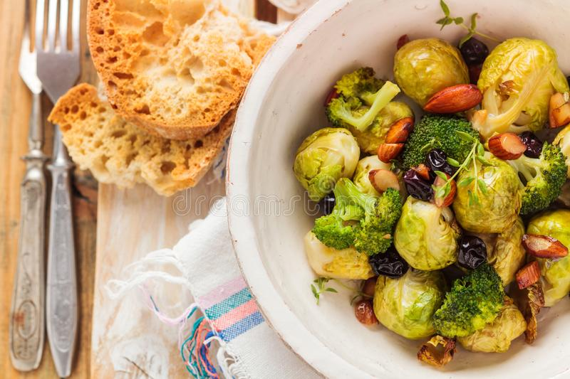 Baked Brussel sprouts. With almonds and grapes stock image