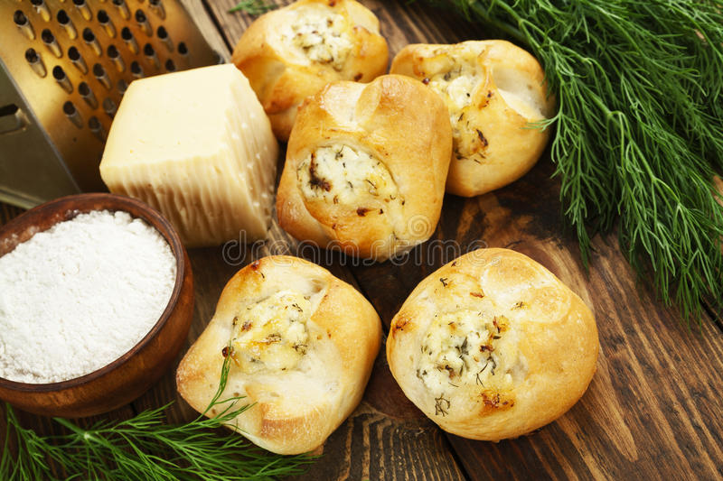 Baked buns stuffed with cheese stock images
