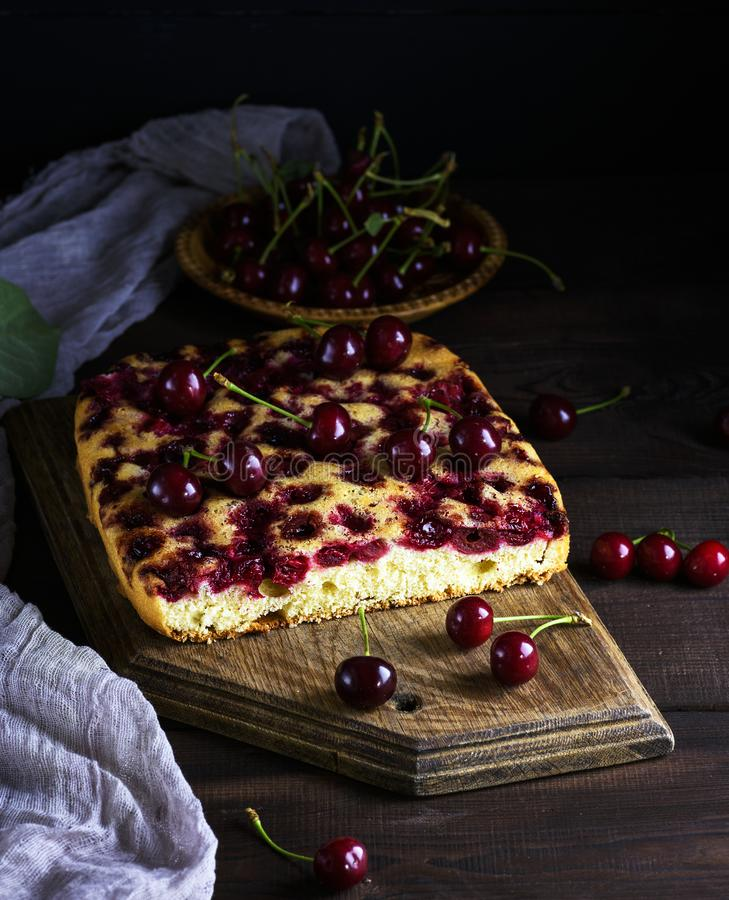 Download Baked Cake With Cherries On A Brown Wooden Board Stock Image - Image of tasty, snack: 118275357