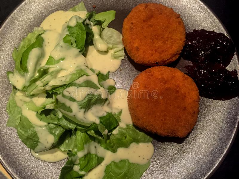 Camenbert. Baked Cheese with Salad and Berries stock photo
