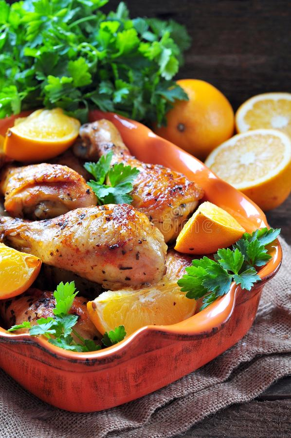 Baked chicken drumstick with orange, smoked paprika, Provencal herbs and olive oil. stock photography