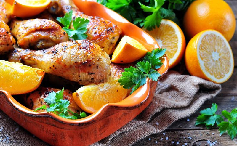 Baked chicken drumstick with orange, smoked paprika, Provencal herbs and olive oil. Food royalty free stock images