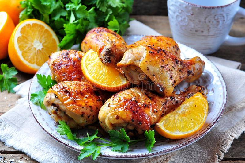 Baked chicken drumstick with orange, smoked paprika, Provencal herbs and olive oil. Food stock image