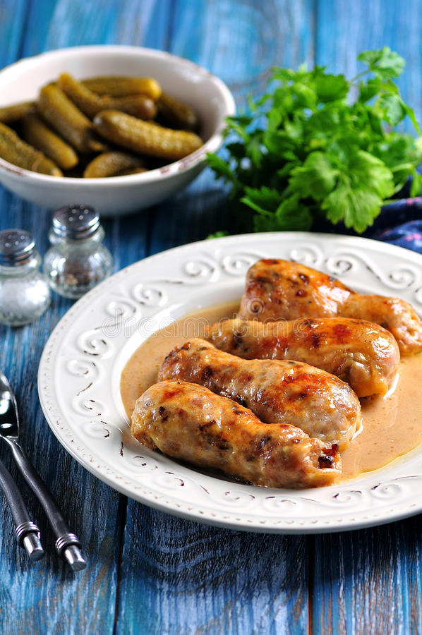 Baked chicken drumsticks stuffed with fried mushrooms and cheese in a creamy sauce. royalty free stock image