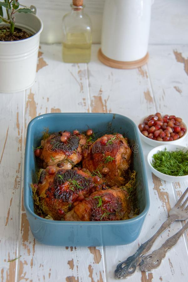 Baked chicken in garnet sauce, garlic and dill royalty free stock image
