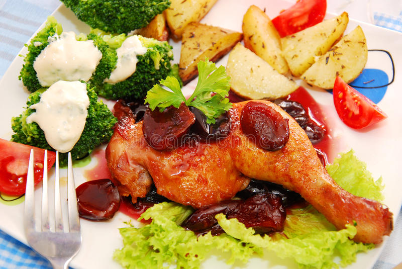 Baked chicken leg in plum sauce stock images