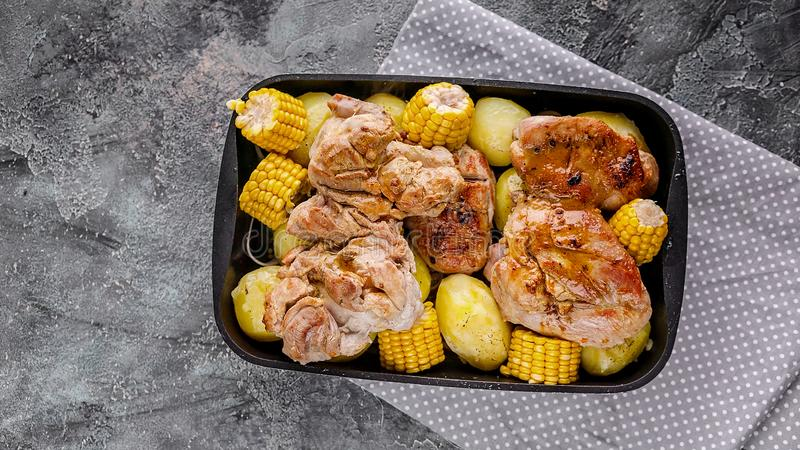 Baked chicken meat with potatoes and corn. White diet meat. Top view stock photography
