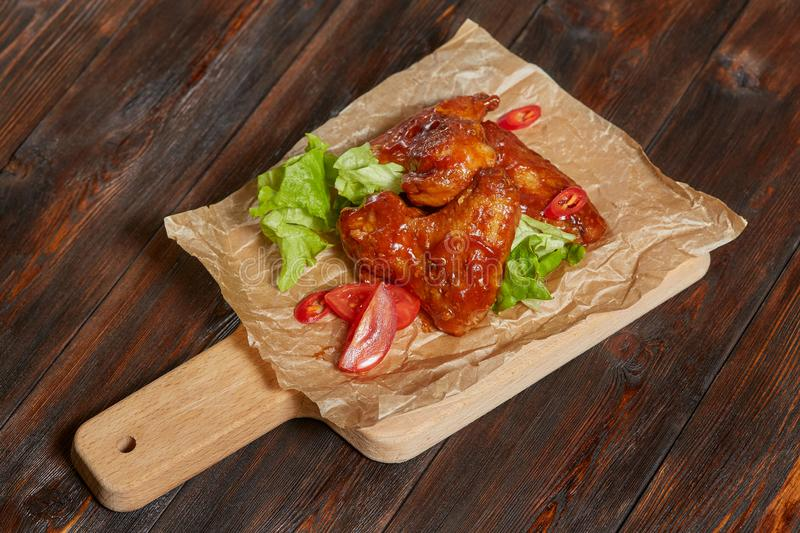 Baked chicken with sweet and sour sauce, meat with vegetables stock image