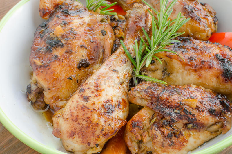 Baked chicken with thyme royalty free stock photos
