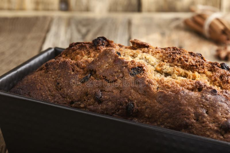 Baked Christmas cake in loaf tin royalty free stock photo