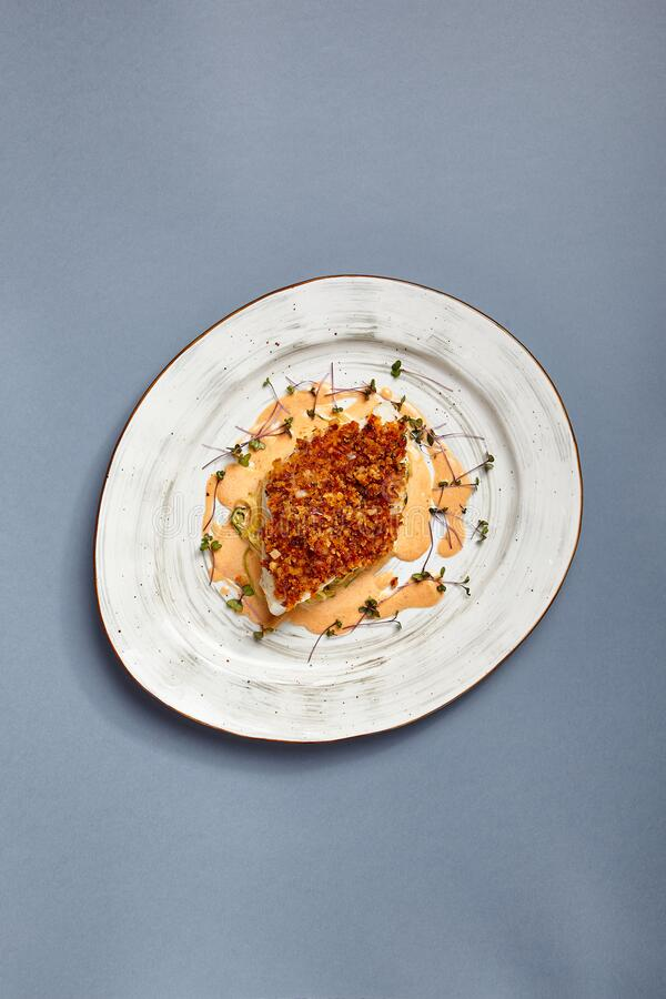 Baked cod fillet with sauce stock photography