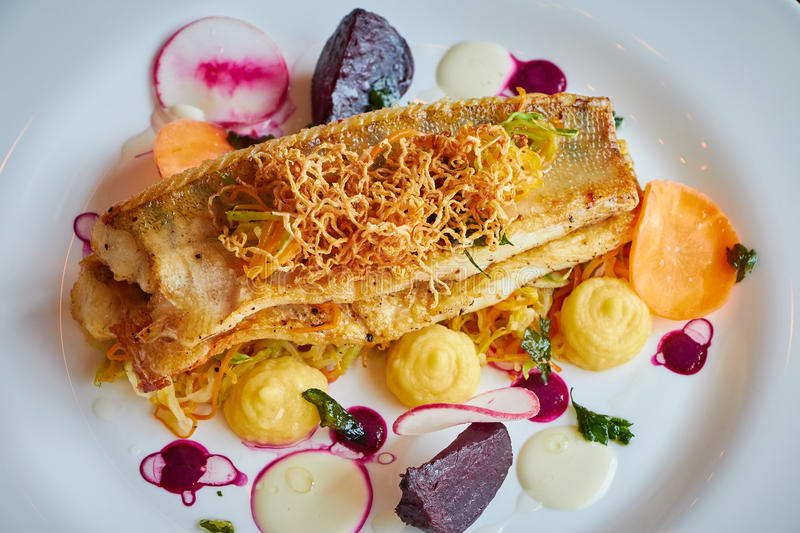 Baked cod fillet with vegetables in close up royalty free stock images