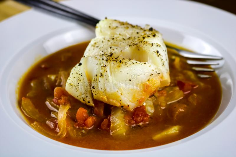 Baked Cod with Tomatoes, Fennel and Onions royalty free stock images