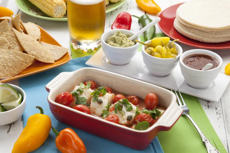 Baked Cod With Tomatoes stock images
