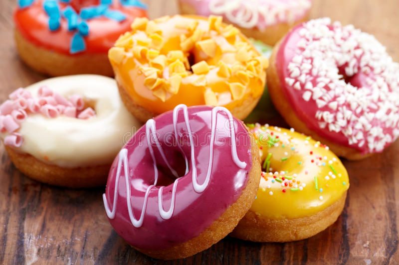 Baked donuts. On old wooden table stock images