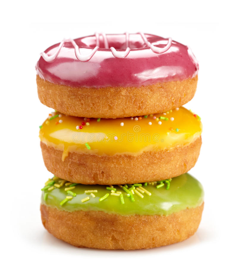 Baked donuts. Three baked donuts on white background royalty free stock photo