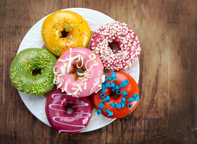 Baked donuts. On white plate stock images