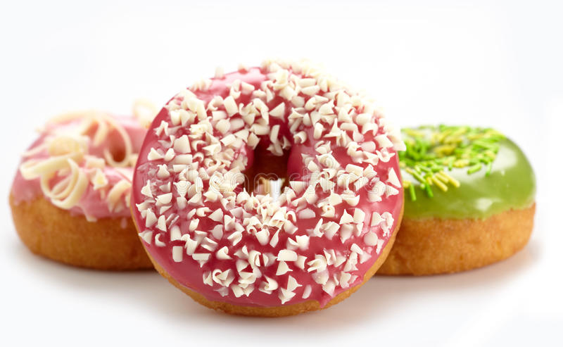 Baked donuts. On white background royalty free stock photos
