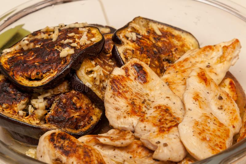 Baked eggplant and chicken. Shot of baked eggplant and chicken royalty free stock photo