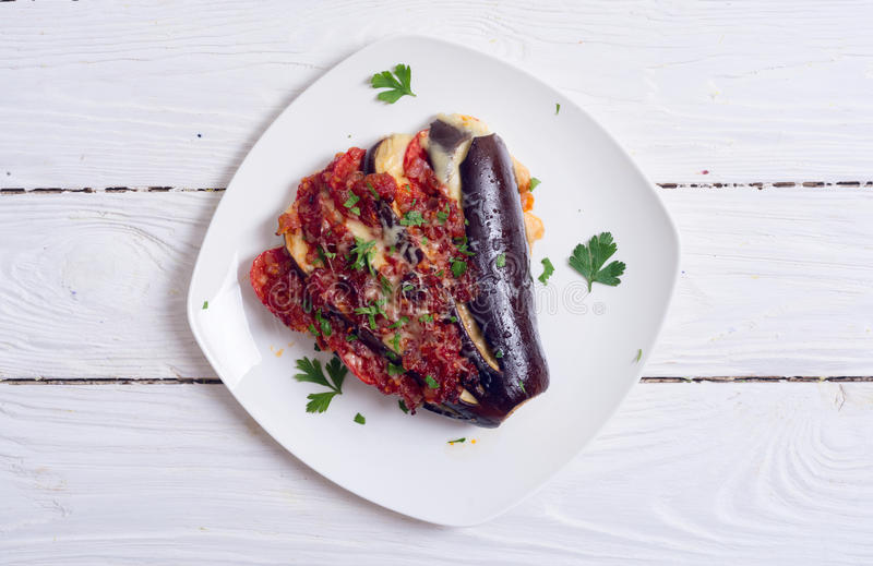 Baked eggplant with tomato stock images