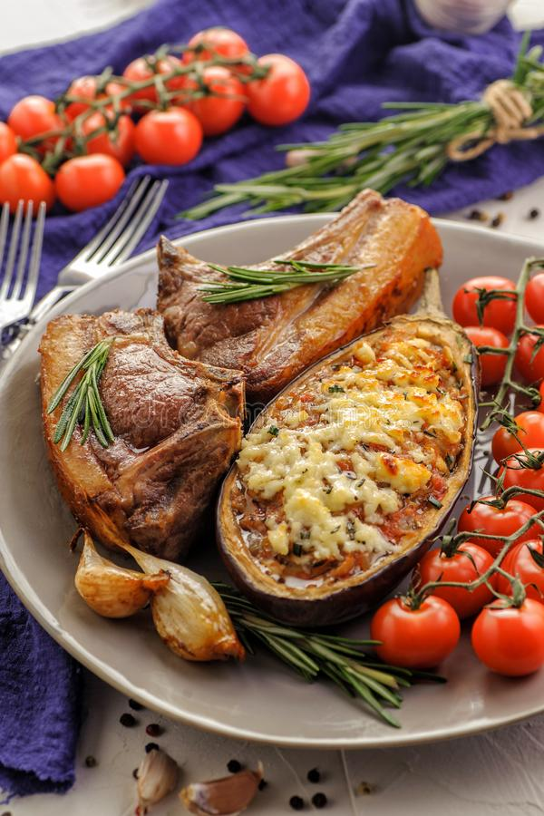 Baked eggplants with roasted meat royalty free stock image