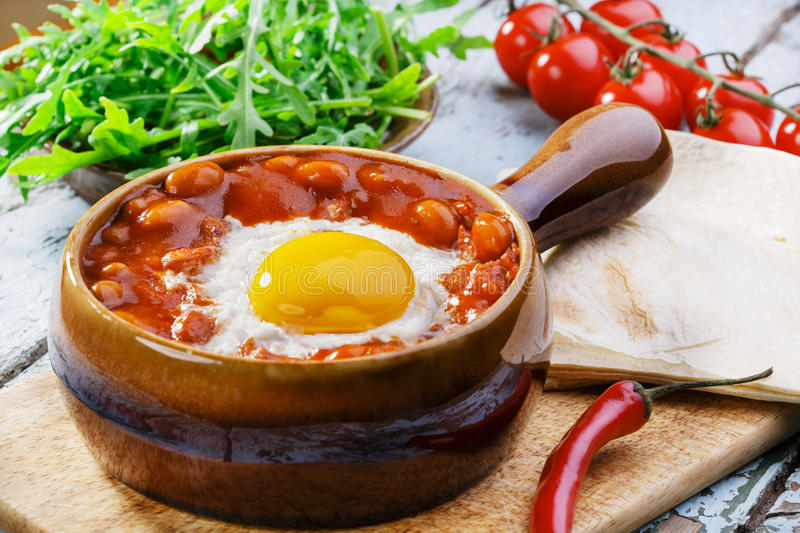 Baked eggs with beans stock photo