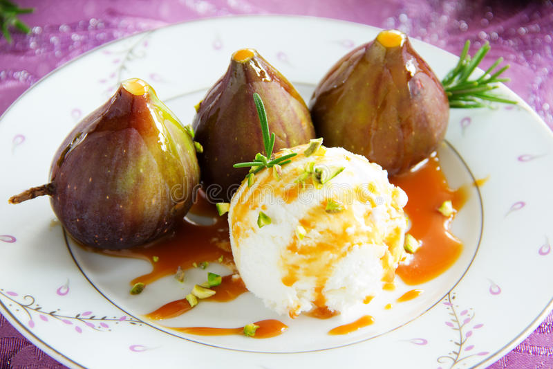 Baked figs with caramel. And ice cream stock photo