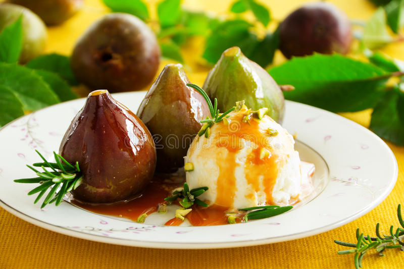 Baked figs with caramel. And spices royalty free stock photography