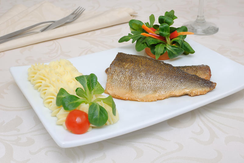 Baked fillet of sea bass. With vegetables and mashed potato mix stock images