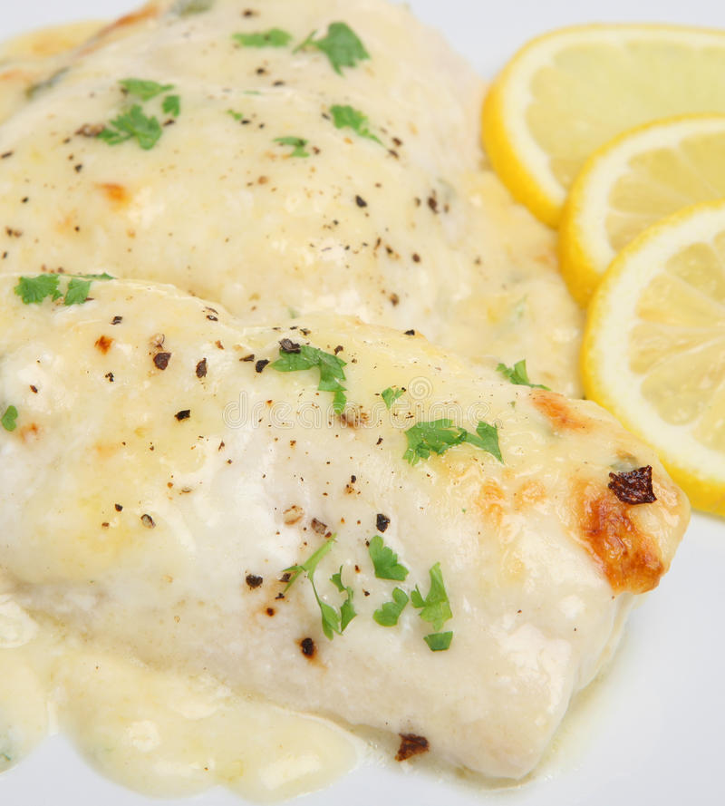 Download Baked Fish in Cheese Sauce stock photo. Image of lemon - 15509936
